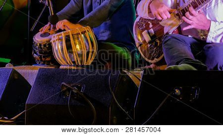 Two Men Playing Traditional Indian Tabla Drums And Sitar On Stage Of Ethnic Open Air Concert. Relaxa