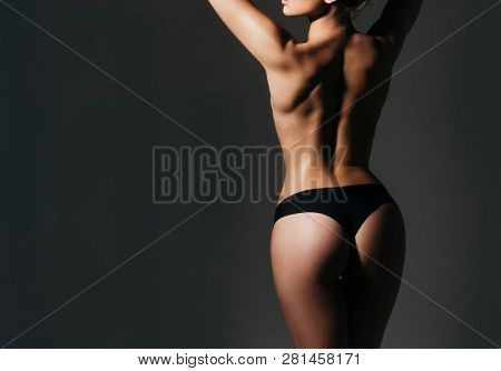 Fitness And Diet. Sexy Female Fetish-wear. Woman In Erotic Underwear. Big Ass. Buttocks After Treatm