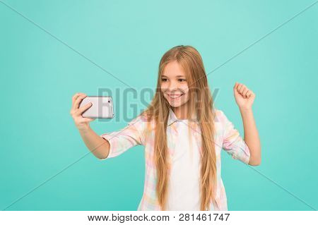 Video Streaming. Adorable Child Learning New Technology. Little Girl Using Mobile Phone. Small Girl