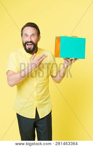 Bearded Mature Man With Shopping Bag On Yellow Background. Sale And Discount. Online Shopping. Profi