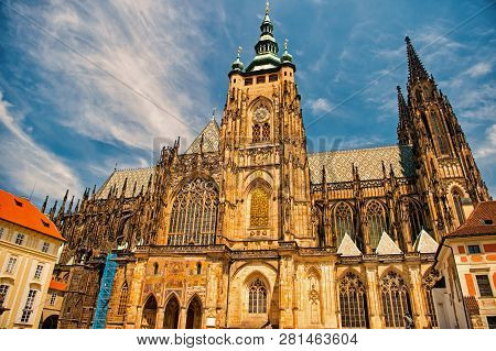 Church Building In Prague, Czech Republic. St.vitus Cathedral On Cloudy Blue Sky. Monument Of Gothic