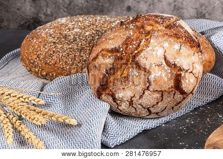 Fresh Fragrant Bread On The Table. Food Concept. Bakery, Crusty Loaves Of Bread And Buns. Assortment