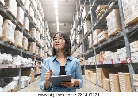 Candid Of Young Attractive Asian Woman Auditor Or Trainee Staff Work Looking Up Stocktaking Inventor