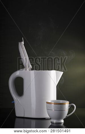 Tea Cup And Electric Kettle With Steam