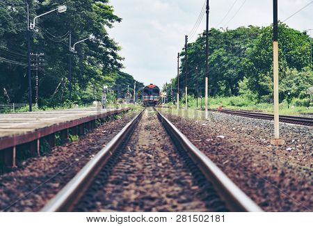 Railroad Tracks Train Leading From Train Station Railway In Countryside Vintage Old Film Style