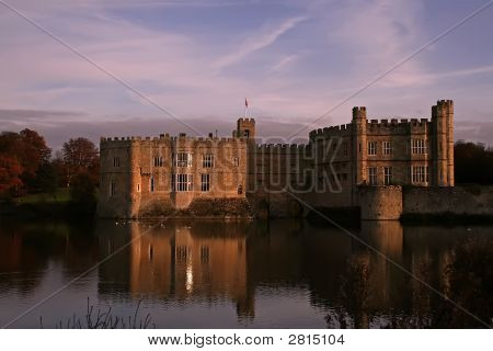 Castle Reflected Into Crystal Moat As The Sun Sets