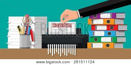 Hand Putting Document Paper In Shredder Machine. Torn To Shreds Document. Contract Termination Conce