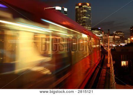 Overland Train Arriving On Platform At Night