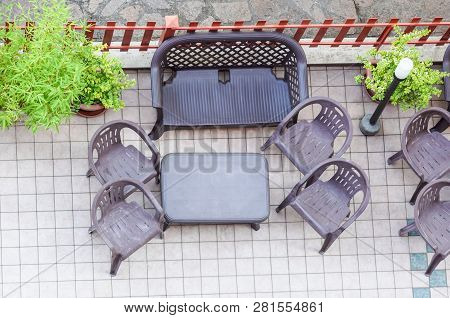 Table And Garden Chair From Above . Sunny Patio With Table And Chairs, High Angle View
