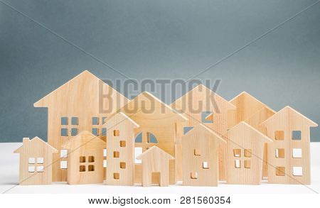 Miniature Wooden Houses. Real Estate. City. Agglomeration And Urbanization. Real Estate Market Analy