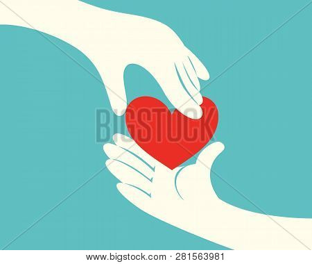 Close Up Of Hand Giving A Red Heart To Another Hand On Green Background
