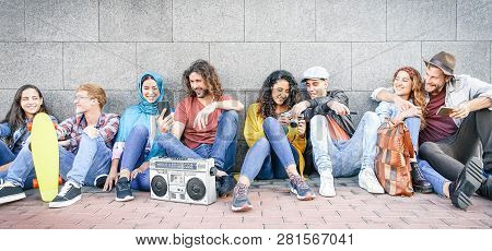 Group Of Multiracial Friends Having Fun Outdoor - Millennial Young People Using Mobile Phones Taking