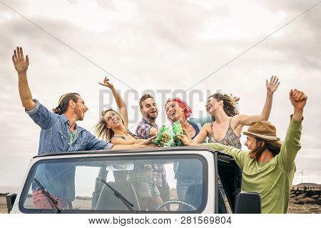 Group Of Happy Friends Cheering With Beer In Convertible Car - Young People Having Fun Drinking And