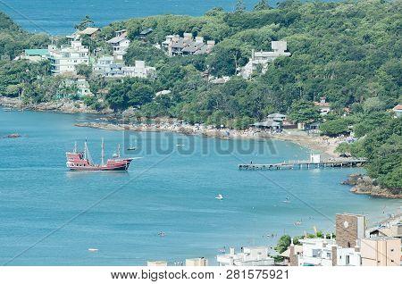 Bombinhas - Sc, Brazil - December 18, 2018: Tourists Onboard Of The Pirate Ship Called Dragao Vermel