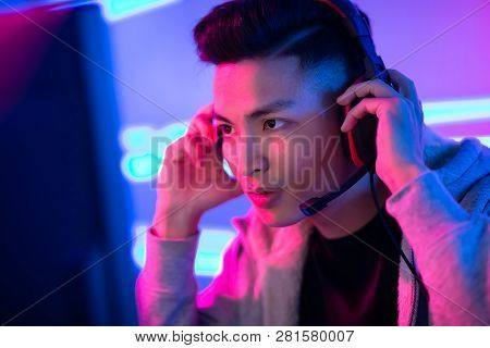 Young Asian Handsome Pro Gamer Wearing Headphones And Ready To Play In Online Video Game