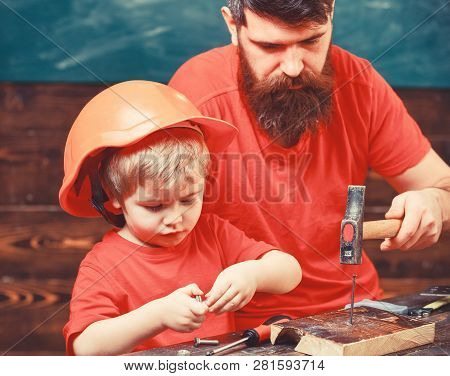 Father, Parent With Beard Teaching Little Son To Use Hobnails And Hammer. Boy, Child Busy In Protect