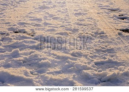 Snow Covered Field With Footprints And Tire Marks In South Lake Tahoe, California, North America