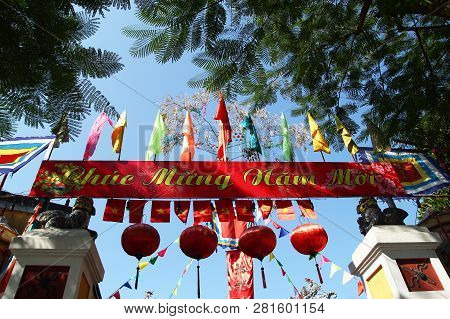 Hoi An, Vietnam - February 15, 2018: Festive Colorful Decorations On A Building For Celebrating Tet