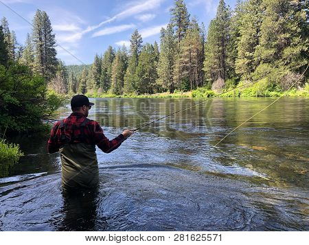 Metolius River Oregon Fly Fishing Trip With Fisherman Casting