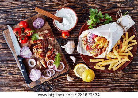Greek Souvlaki - Pita Wrap With Grilled Shaved Gyros Meat, Vegetables, French Fries And Yogurt Garli