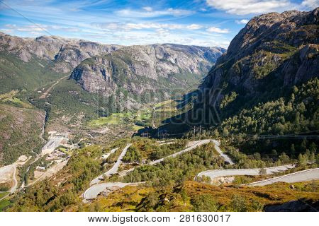 Aerial view of Lysebotnvegen hair pinned road leading to Lysebotn village at the end of Lysefjord (Lysefjorden) from the mountain plateau, one of the most famous hairpinned roads in the world