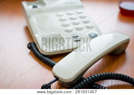 Modern Digital Phone, Isolated On Wooden Background.the Image Of Telephone. Voip Telephone Conferenc