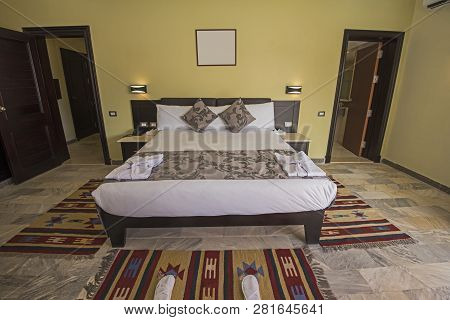 Double Bed In Suite Of A Luxury Hotel Room With En Suite Bathroom