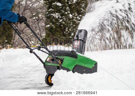 Snowblower In Action Being Pushed After Snowfall And Ice On A Cold Winter Day In Rural Northeast Usa