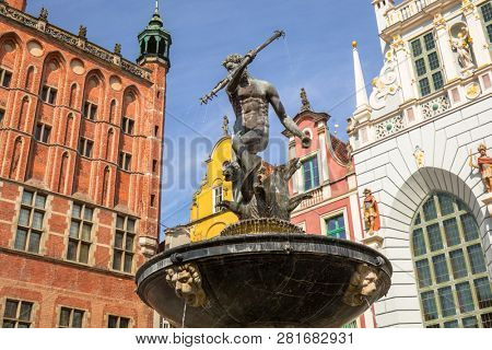 Gdansk, Poland - September 1, 2018: Neptune fountain of the old town in Gdansk, Poland. Gdansk is the historical capital of Polish Pomerania with medieval old town architecture.