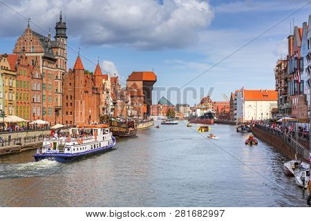 Gdansk, Poland - September 1, 2018: Architecture of the old town in Gdansk at Motlawa river, Poland. Gdansk is the historical capital of Polish Pomerania with medieval old town architecture.