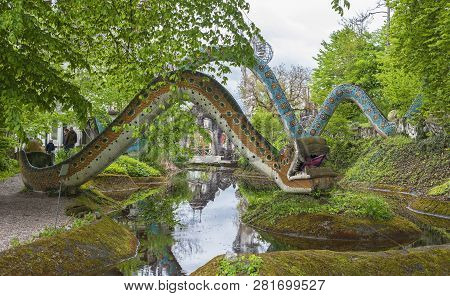 Dietikon, Switzerland - April 2017: Dragon Statues On The Pond In Bruno Weber Park