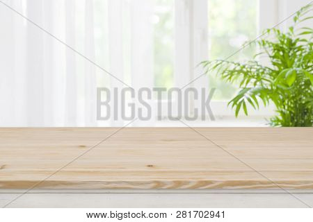 Top Of Brown Wood Table On Blurred Curtained Window Background