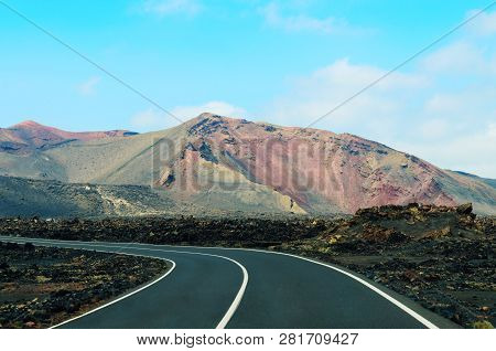 Road In Timanfaya National Park In Lanzarote,canary Islands,spain. The Spectacular Volcanic Landscap