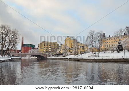 Tampere, Finland. Embankment Of The River Tammerkoski In A Cloudy Winter Day
