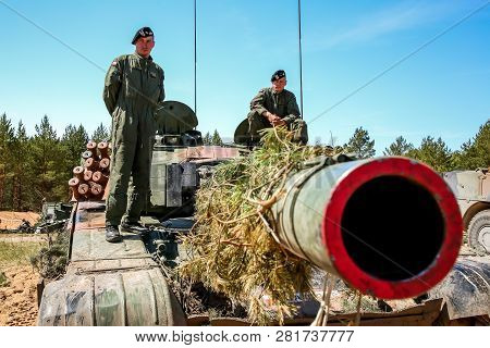 Nato Soldiers On Tank Abrams. International Military Training