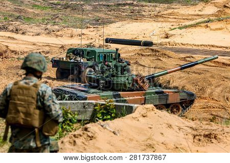 Tanks, Military Vehicles And Soldiers. Nato Soldiers And Military Equipment In Latvia. International