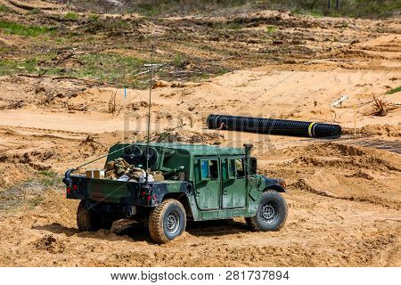 Nato Hummer Military Vehicles. Soldier On Armored Hummer. International Military Training