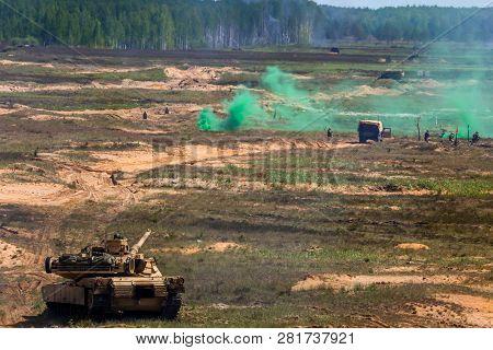 Tank Abrams Shoot. Explosion, Smoke And Military Vehicles. International Military Training