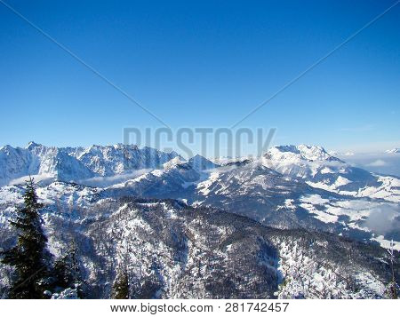 Panorama of the Kaisergebirge in Tyrol Austria with the wild emperor on the left side and the tame emperor in the middle. Winter landscape poster