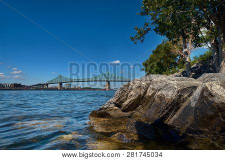 Jacques Cartier Bridge Spanning Over The Saint Lawrence River
