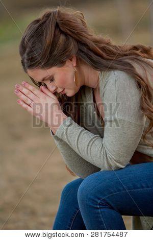 Brunette mode in prayer pose