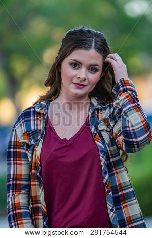 Young brunette female posing outdoors