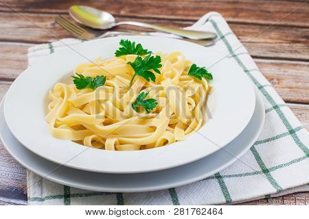 Tagliatelle On White Plate Ready For Eat