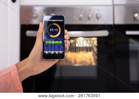 Woman Operating Oven Application
