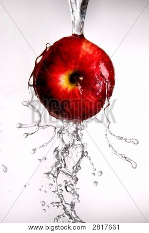 Water Pouring Over Apple On White Isolated