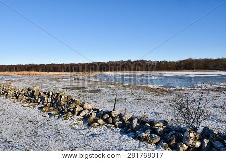 Winter Landscape With An Old Traditional Stone Wall At The Swedish Island Oland