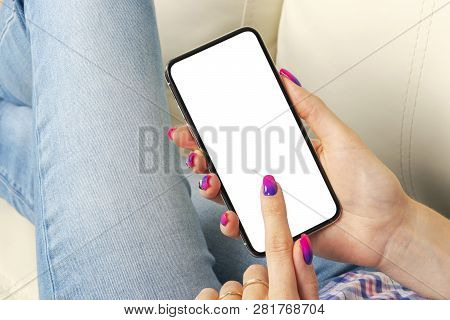 Smartphone Mockup In Woman Hand. New Modern Black Frameless Smartphone Mock Up With Blank White Scre