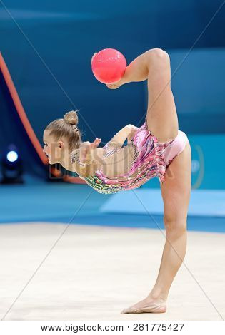 KIEV, UKRAINE - AUGUST 28, 2013: Laura Jung, Germany performs with ball during 32nd Rhythmic Gymnastics World Championships. The event is held in Palace of Sport