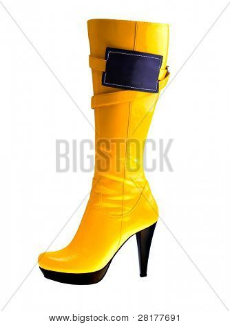 Stylish high heel fashion yellow boot with empy label  isolated on white