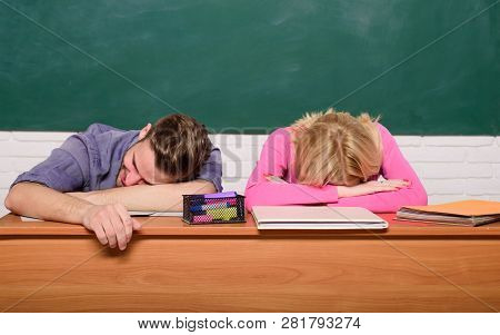 Student Life Issues. Guy And Girl Tired Or Lazy Student Lean On Desk In Classroom. Feeling Bored. St